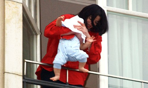 Michael Jackson dangling baby at hotel adlon